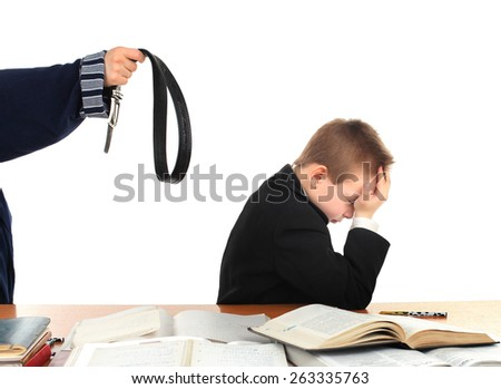 parent threatening son with a belt - stock photo