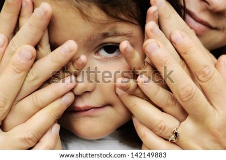 parental palms hugging her daughter's face. - stock photo