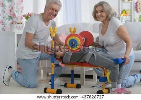 parents and granddaughter doing exercise - stock photo