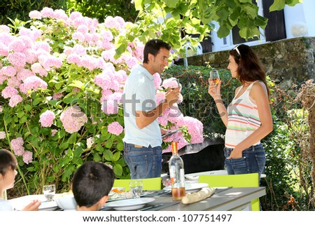 Parents cheering with wine on barbecue day - stock photo