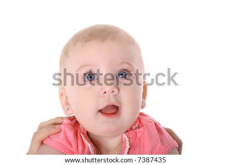parents hands holding happy little baby girl - stock photo