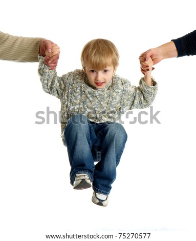 parents hold the child's hands - stock photo