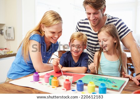 Parents Painting Picture With Children At Home - stock photo
