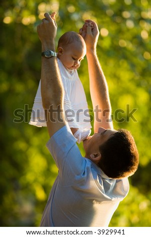 parents playing with baby - stock photo