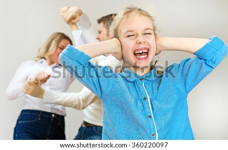 Parents quarreling at home, child is screaming. - stock photo