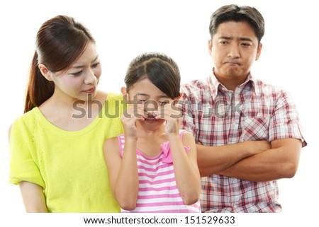Parents scolding child - stock photo