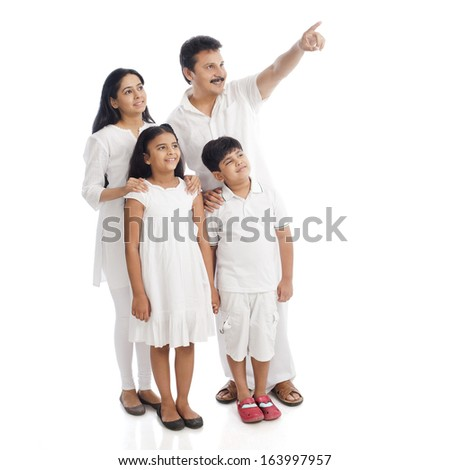 Parents standing with their children - stock photo