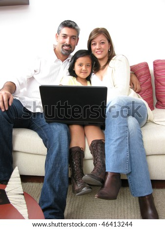 Parents whit son look in notebook on white background - stock photo