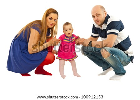 Parents with baby girl making first steps isolated on white background - stock photo