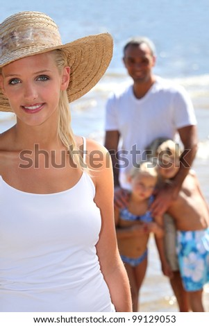 Parents with children on the beach - stock photo