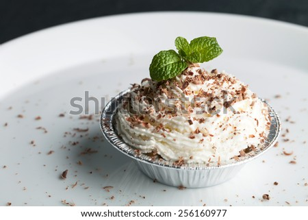 Parfait dessert with fresh whipped cream and chocolate shavings. Shallow depth of field. - stock photo