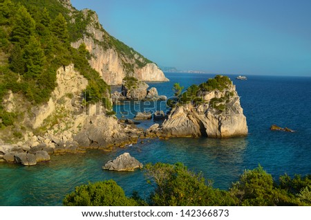 Parga Greece blue sea cliff pines green - stock photo