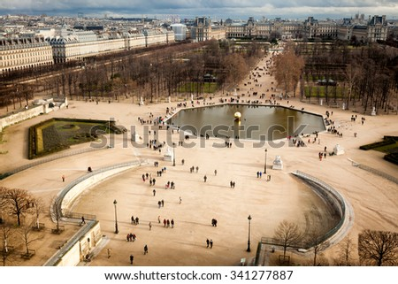 Paris aerial view of the Tuileries Garden at Christmas, looking toward the Louvre from the top of the ferris wheel near the Obelisk. - stock photo