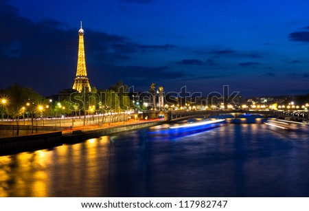 PARIS - APRIL 24: Cityscape of Paris with Eiffel Tower at night on April 24, 2012. The Eiffel tower is the most visited monument of France with about 6 million visitors every year. - stock photo