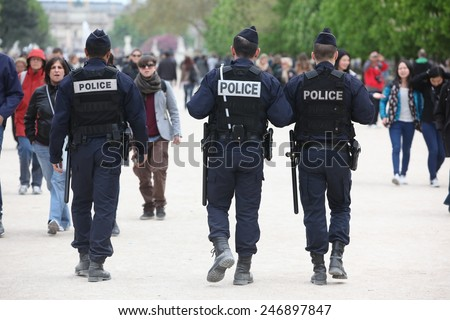 PARIS - APRIL 27: French police control the street, Paris the 27 april 2013, France. Paris is one of the most populated metropolitanareas in Europe - stock photo