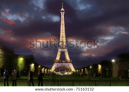PARIS - APRIL 02 : Light Performance Show on April 02, 2011 in Paris. The Eiffel tower  stands 324 metres (1,063 ft) tall. Monument was built in 1889, attendance is over 7 millions people. - stock photo