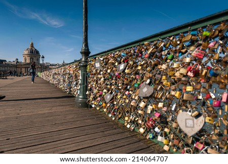 PARIS - APRIL 14: Lockers at Pont des Arts symbolize love for ever, April 14, 2013 in Paris. 16000 lockers of loving couples are on that bridge, also known as Passarelle des Arts - stock photo