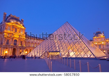 PARIS - APRIL 16 :Louvre at dusk on April 16, 2010 in Paris. Summer Exhibition at Louvre Museum - stock photo