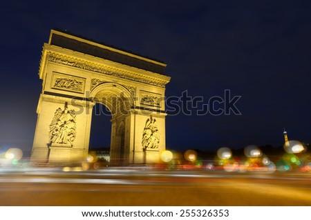 Paris - Arc de Triomphe and place Charles de Gaulle at night - stock photo