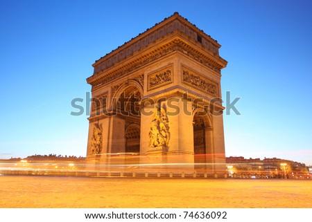 Paris, Arc de Triumph at evening - stock photo