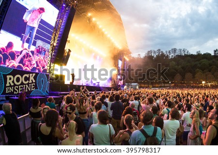 PARIS - AUG 31: Crowd in a concert at Rock En Seine Festival on August 31, 2015 in Paris, France. - stock photo