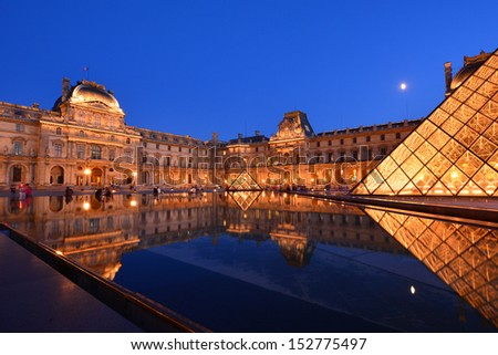 PARIS - AUG 15 : Louvre museum at twilight in summer on August 15,2013. Louvre museum is one of the world's largest museums with more than 8 million visitors each year. - stock photo
