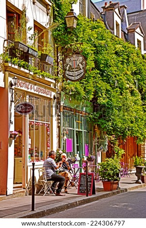 PARIS -August 18: Beautiful confectionery on the narrow streets of Ile de la Cite on August 18, 2014, Paris, France - stock photo
