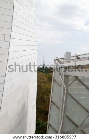 PARIS - AUGUST 29: Eiffel Tower seen from the Foundation Louis Vuitton in Paris, France on 29 August 2015 - stock photo