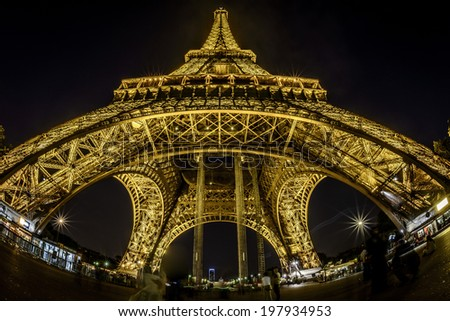 Paris - August 28: Fish-Eye view of Eiffel Tower at night on August 28, 2013 in Paris, France - stock photo