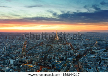 PARIS -  6  AUGUST  2013: Illuminated Eiffel Tower at night and people on the Champs de Mars. The popular place for people for romantic evenings - stock photo