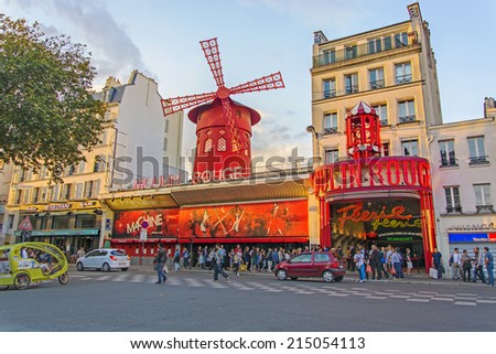 PARIS - August 16: Moulin Rouge on August 16, 2014 in Paris, France. The Moulin Rouge is a famous cabaret in Paris, built in 1889 and located in the red light district of Pigalle. - stock photo