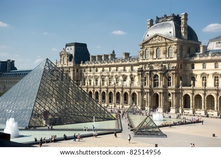 PARIS-AUGUST 2: The Louvre Art Museum on August 2, 2011 in Paris. The history of this most famous museum goes back 800 years of continuous transformations from fortress to palace and today museum. - stock photo
