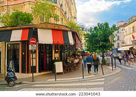 PARIS -August 16: View of typical paris cafe in the artists' quarter of Montmartre on August 16, 2014, Paris, France - stock photo