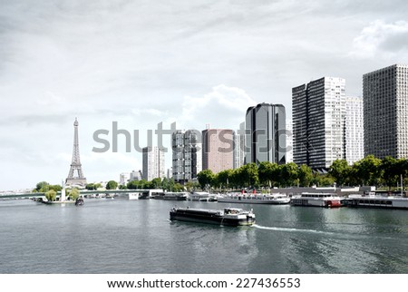 Paris, barge on the Seine and Eiffel tower, view from a bridge - stock photo