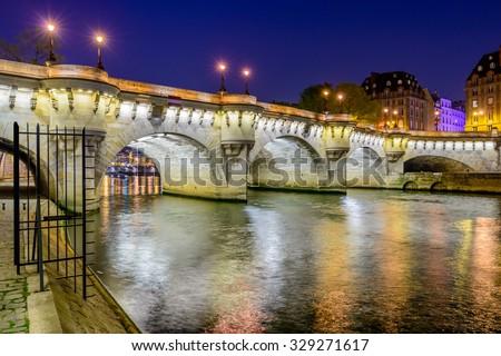 Paris bridge and Seine river at night. - stock photo