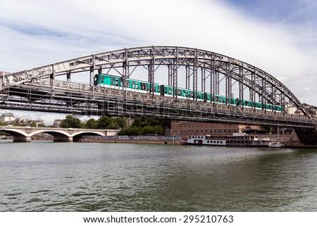 Paris bridge over river Seine with subway passing - stock photo