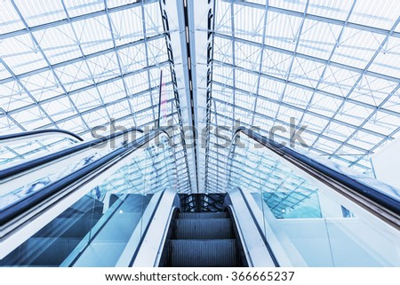 PARIS Charles de Gaulle Airport - 20 JAN 2016. Escalator at the airport PARIS Charles de Gaulle. Colored in blue-gray Technical - stock photo