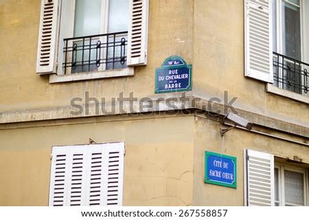 Paris classic blue street sign on a street corner, France - stock photo