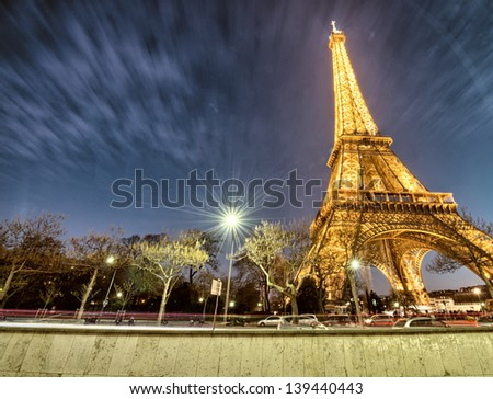 PARIS - DEC 1 : Eiffel tower at night, December 1,2012 in Paris. The tower is the tallest structure in Paris and the most-visited paid monument in the world; 7.1 million people ascended it in 2011. - stock photo