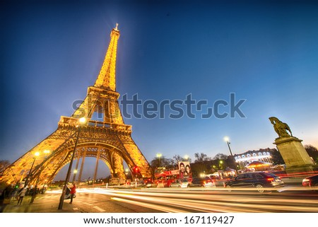 PARIS - DEC 1: Lighting the Eiffel Tower December 1, 2012 in Paris. Established in 1985, the new system allowed the tower to glow golden glow. - stock photo