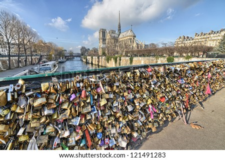 PARIS - DEC 1: Lockers at Pont des Arts symbolize love for ever, December 1, 2012 in Paris. 16000 lockers of loving couples are on that bridge, also known as Passarelle des Arts - stock photo