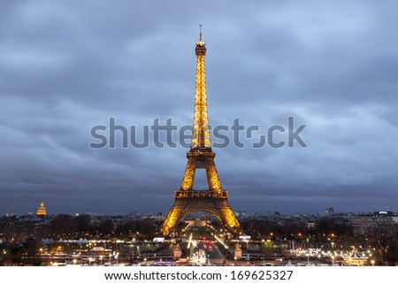 PARIS - DECEMBER 27, 2013: Eiffel Tower at dusk from Trocadero on December 27, 2013 in Paris. The Eiffel tower is the most visited monument of France with about 6 million visitors every year. - stock photo