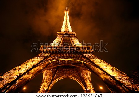 PARIS - DECEMBER 8: Eiffel Tower Light Performance Show in Dusk December 8, 2005. The Eiffel tower is one of the most visited monument on the world. Originally build for radio transmitter station. - stock photo