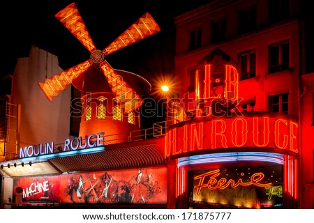PARIS - DECEMBER 10: The Moulin Rouge by night, on December 10, 2012 in Paris, France. Moulin Rouge is a famous cabaret built in 1889, locating in the Paris red-light district of Pigalle  - stock photo