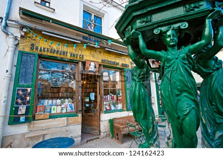 PARIS-DECEMBER 11: The Shakespeare and Co. bookstore on December 11, 2012 in Paris, Opened in 1951 by George Whitman near Notre Dame,is a reading library, specializing in English-language literature. - stock photo