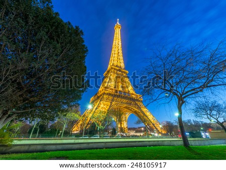 PARIS - DECEMBER 1, 2012: Wonderful night illumination of Tour Eiffel. Eiffel Tower is the most visited monument in France. - stock photo