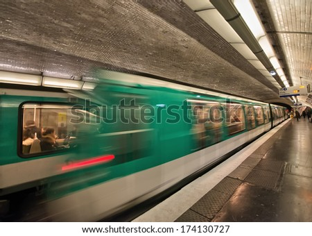 Paris. Departing Train from a Metro Station. - stock photo