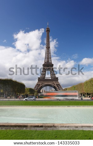 Paris, Eiffel tower with city bus in  France - stock photo