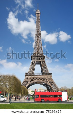 Paris, Eiffel tower with red bus - stock photo