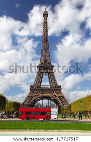 Paris, Eiffel tower with red bus, France - stock photo
